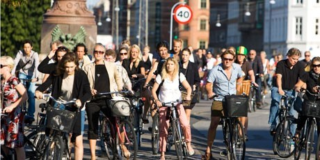 Cyclists waiting to cross one of the bridges in Copenhagen