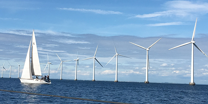 The photo is a file photo showing offshore wind turbines